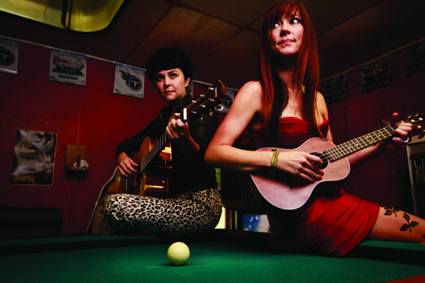 Coco Hames and Amanda Shires show off the Yamaha AC3M guitar and Lanikai Tenor ukulele.