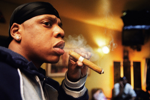 Jay-Z smoking a cigarette (or weed)