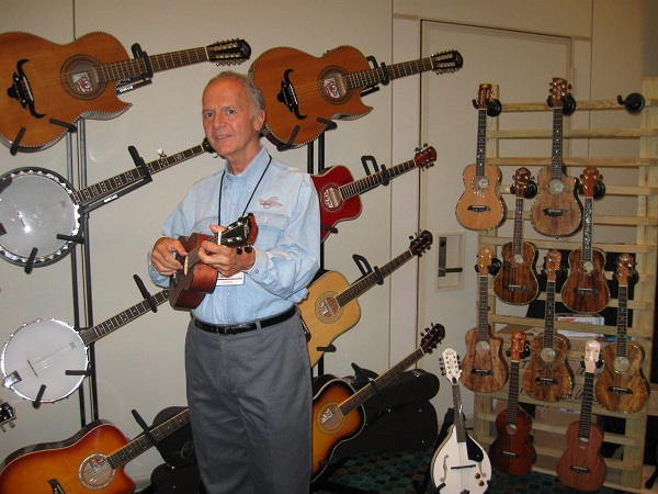 U.S. Music's Tom Ferrone plays the ukulele, one of several instruments marketed by the company.
