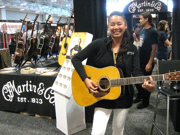 Martin's Kit Culpepper shows off her barre chording skills on Martin's D-180 Dreadnought.