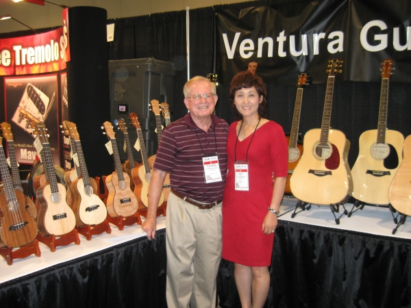 Thomas and Lily Oliphant of Ventura Guitars show off their products, which are not sold over the Internet but in brick and mortar stores only.