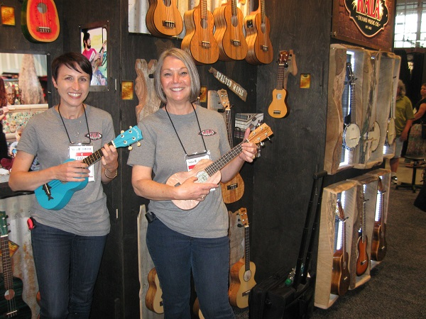 Leanne McClellon and Linda Boswell uke it up in the Kala Music Company booth.