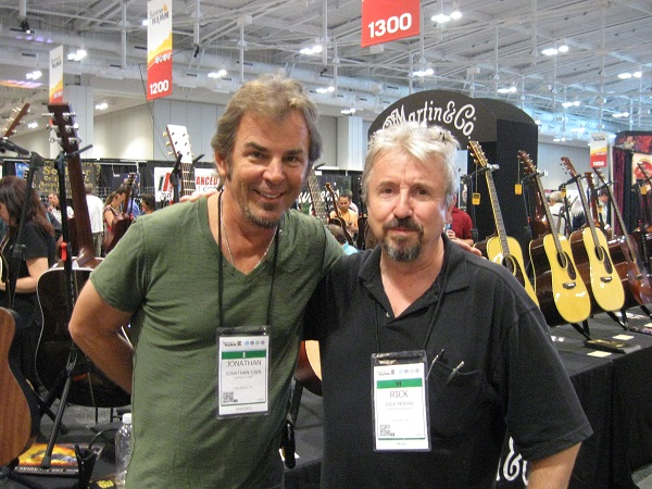 Journey keyboardist/guitarist/vocalist/composer Jonathan Cain visits with American Songwriter contributor Rick Moore at the Martin booth.