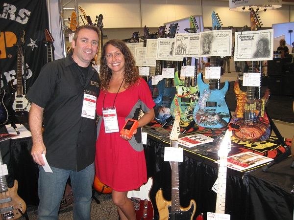 Eric Oppenheimer of ESP guitars and Steffenee Copley of Go-Go Tuners with some guitars from ESP's LTD line that features custom graphics from old horror movies.