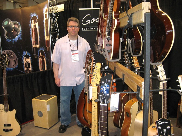 Mike Olienechak runs the booth for Godin, the Canadian guitar maker whose models include the acoustic Seagull.