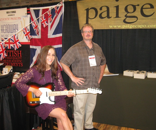 Australia's Amber Slade and company owner Brian Paige with Paige capos, which makes capos for a variety of string instruments and features a capo with a quick-release button.