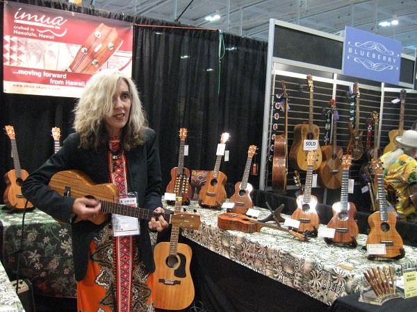 Veteran Nashville songstress Donna Frost working the booth for Imua Ukuleles.