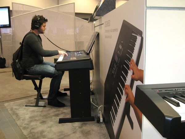 Decatur, Illinois bass player Adam Cunningham checks out a keyboard at the Yamaha booth.