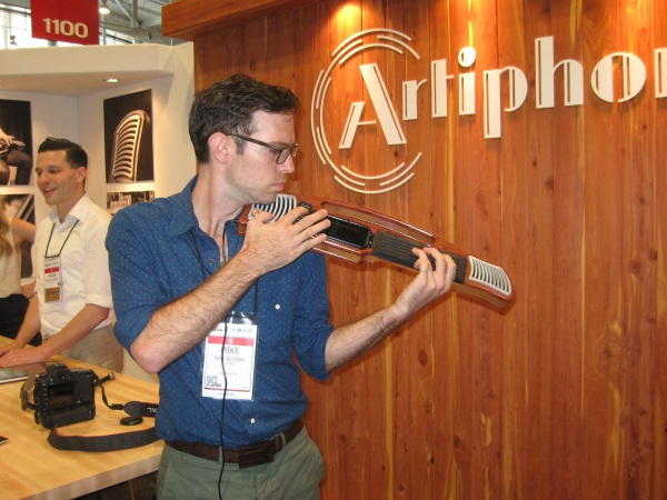 Mike Butera demonstrates the Artiphon INSTRUMENT 1, a wooden instrument with speakers that controls thousands of iOS apps via MIDI, designed for use with the iPhone and the iPod Touch