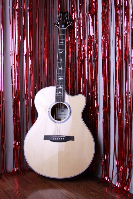 With a street price of $859, the PRS SE Angelus Custom Cutaway acoustic-electric is one of the best guitars in this price range on the current market.