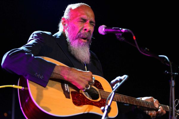 """6. """"Just Like A Woman"""" by Richie Havens: Few interpreters of Dylan's work have been able to get inside of it and make it their own like Havens. His quick-fingered guitar work on this classic ballad gets the crowd going, but it's the deep wisdom in his voice that really clinches the deal."""