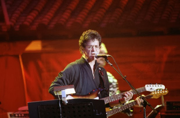 """3. """"Foot Of Pride"""" by Lou Reed: Instead of going with one of the well-known anthems like so many of the performers here, Reed pulled out this Bootleg Series tongue-twister, significantly upping the degree of difficulty. Needless to say, he rises to the occasion and gives a reckless, ramshackle effort that hits harder than many of the more respectful tributes of that evening."""
