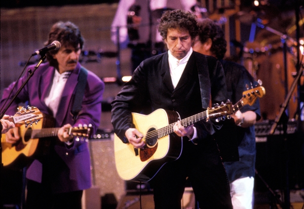 """8. """"Absolutely Sweet Marie"""" by George Harrison: It was Harrison's first live U.S. performance in 18 years, but he is in great voice and nails the sardonic nature of Dylan's lyrics. George plays an acoustic guitar here, leaving the electric heroics to G.E. Smith and Steve Cropper, who trade off furious licks."""