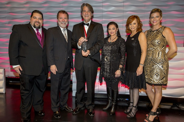 Pictured (left to right): SESAC's Tim Fink & Dennis Lord, Richard Leigh, Crystal Gayle, Reba McEntire and SESAC's Shannan Hatch.