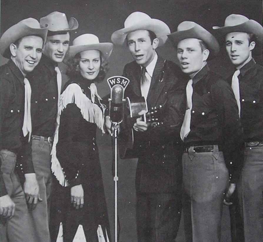 Hank Williams, Audrey Sheppard Williams and the Drifting Cowboys band, in 1951. Public Domain.