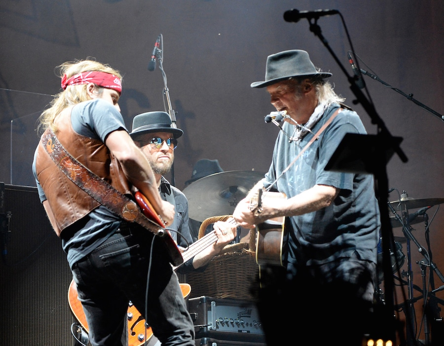 INDIO, CA - OCTOBER 15: Musicians Lukas Nelson, Corey McCormick and Neil Young of Neil Young & Promise of the Real perform onstage during Desert Trip at The Empire Polo Club on October 15, 2016 in Indio, California. (Photo by Kevin Mazur/Getty Images for Desert Trip)